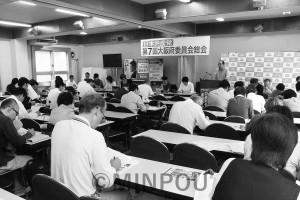 府委員会総会で報告する柳委員長=6日、大阪市天王寺区内